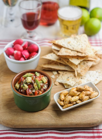 Wasabi and tomato salsa with radishes and tortilla crisps